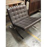 A modern design chrome and leather Barcelona Chair.