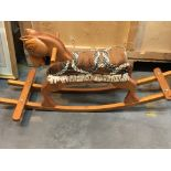 A carved wood rocking horse. Hight 48cm
