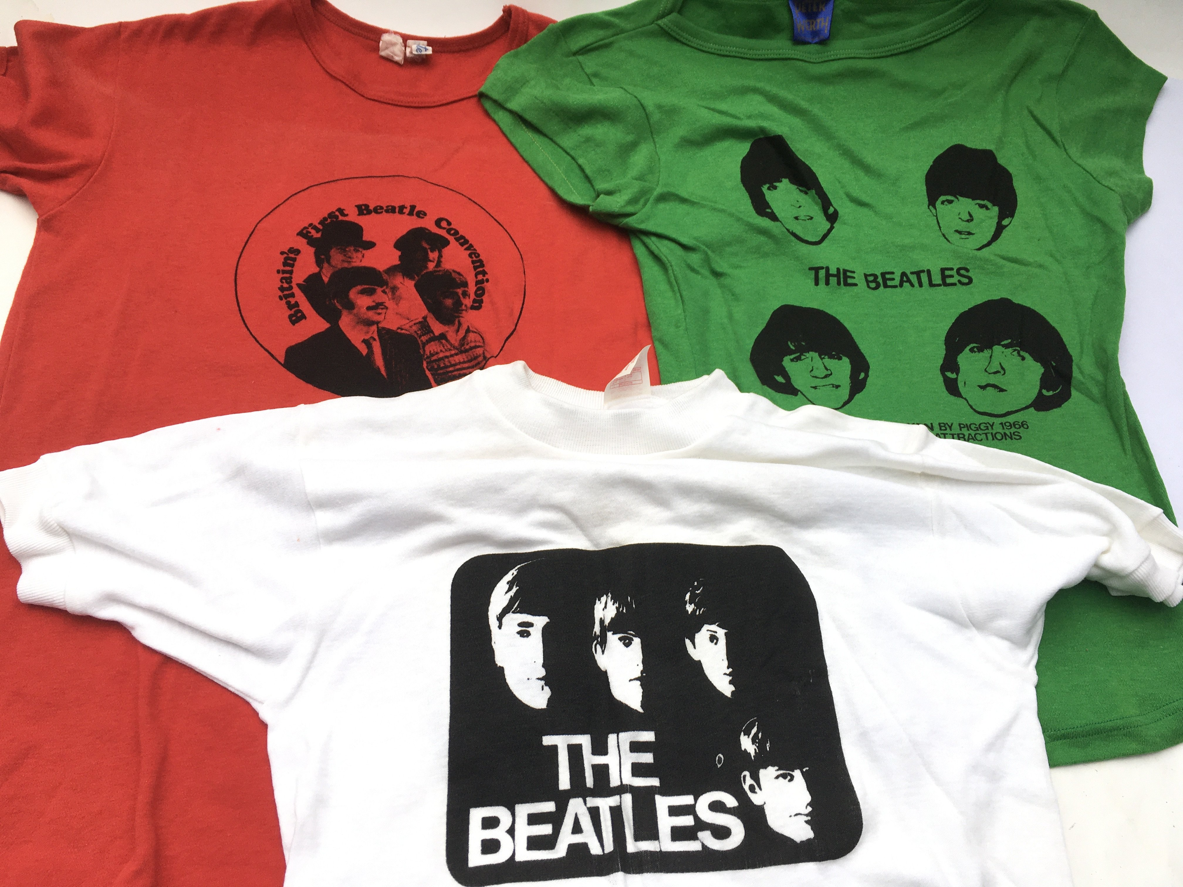 A collection of vintage Beatles t-shirts and sweat