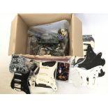 A box of guitar parts comprising three loaded Stra