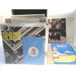A collection of Beatles and solo press packs inclu