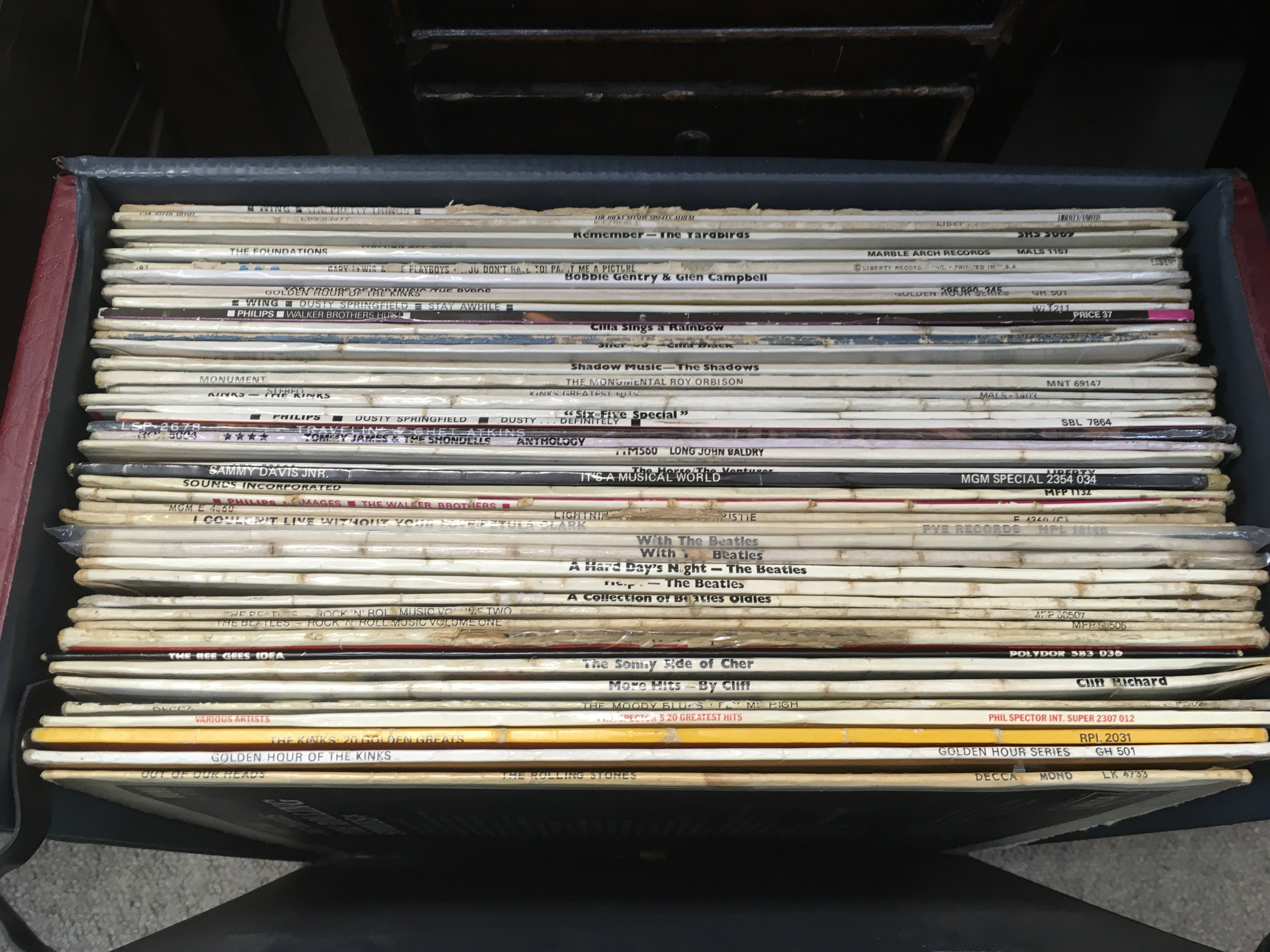 A record case of LPs by artists from the 1960s inc