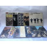 A collection of eighteen Beatles and related LPs c