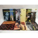 Sixteen Jerry Lee Lewis LPs.