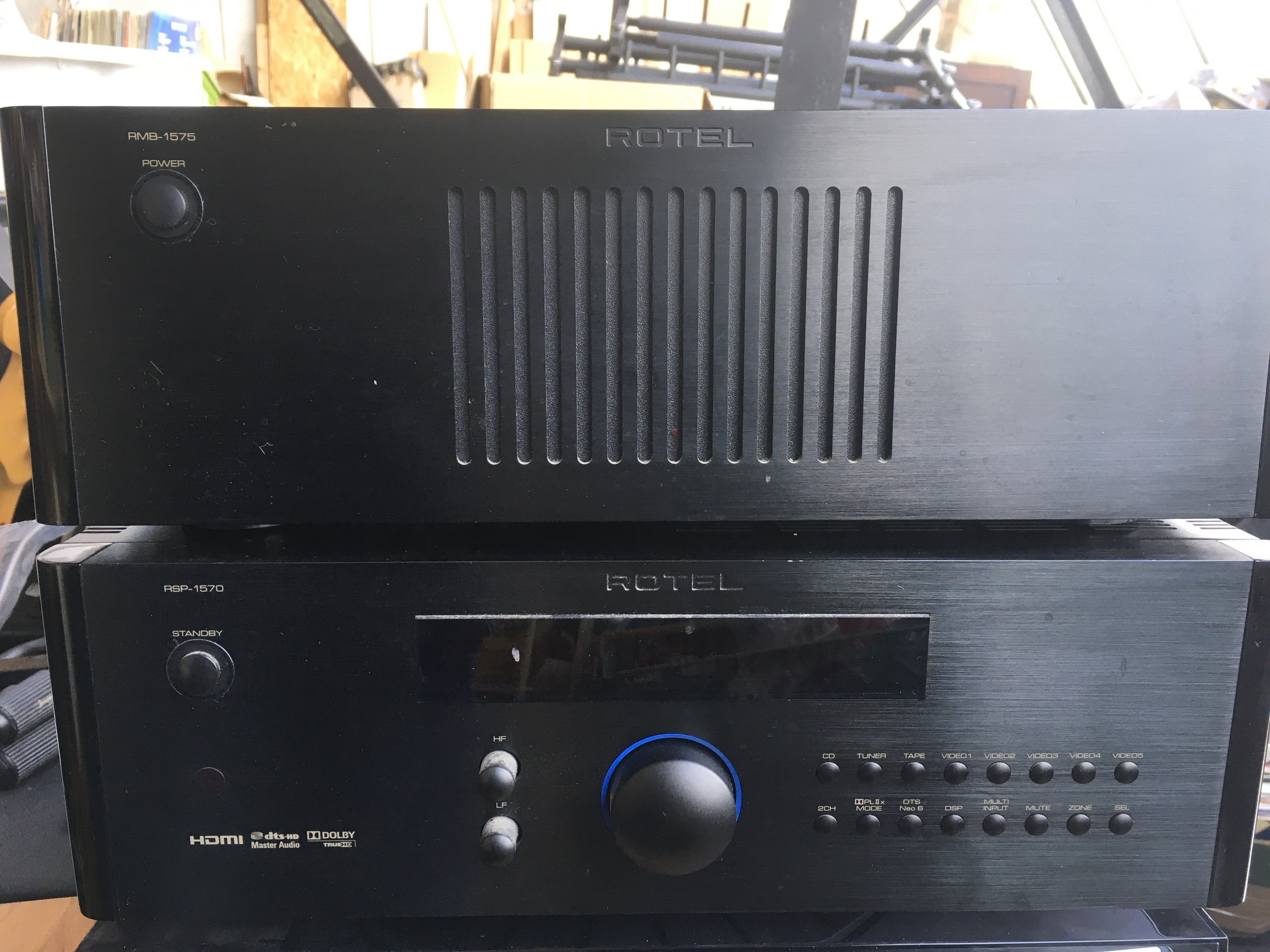 A Rotel five channel power amplifier RMB 1575 toge