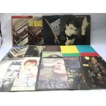 Twelve LPs by various artists including David Bowi