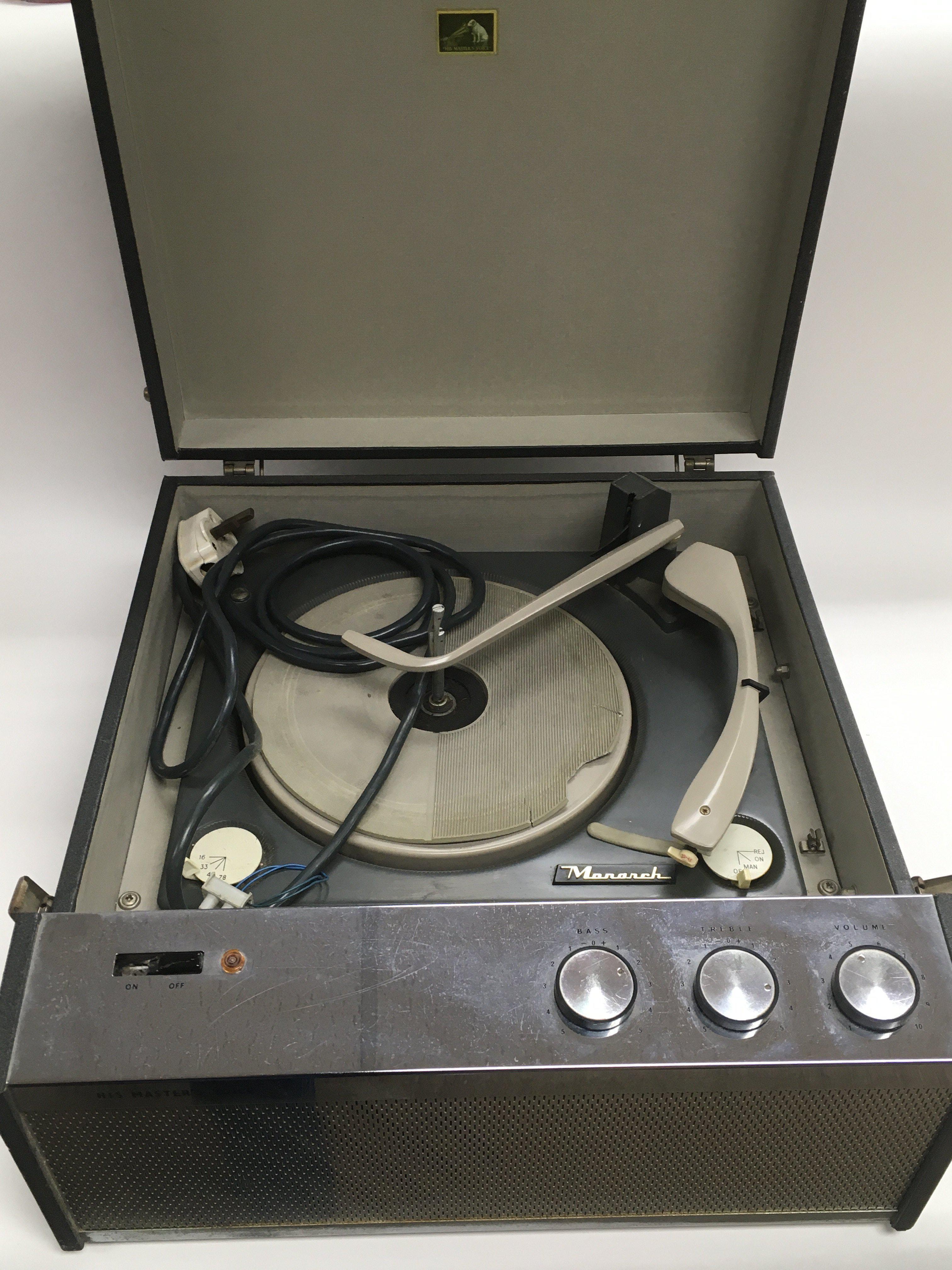 A vintage HMV portable record player.