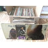 A box containing over 100 LPs and 12inch singles,