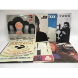 Seven solo Beatles and cover version LPs together