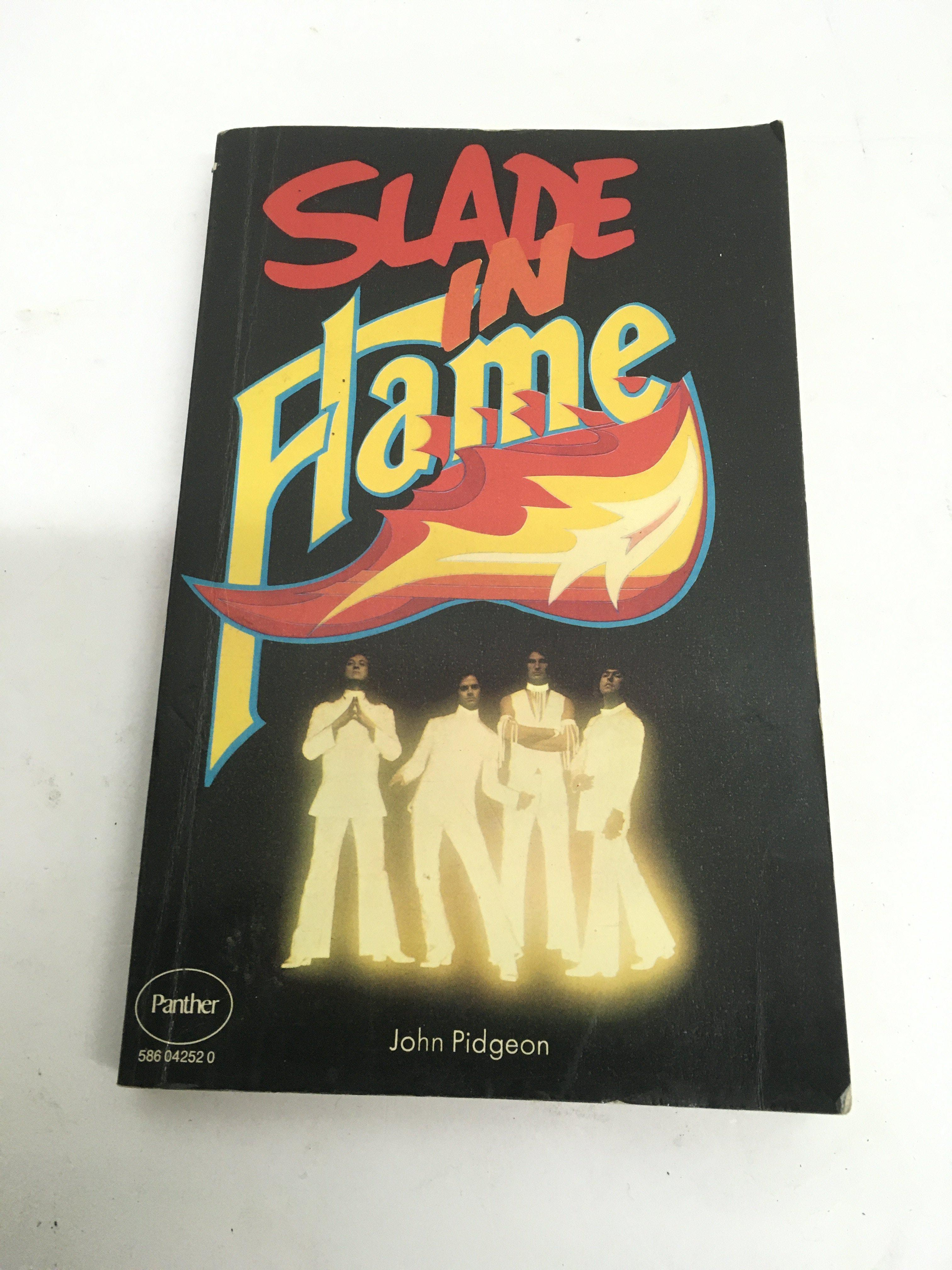 A fully signed 'Slade In Flame' paperback book.
