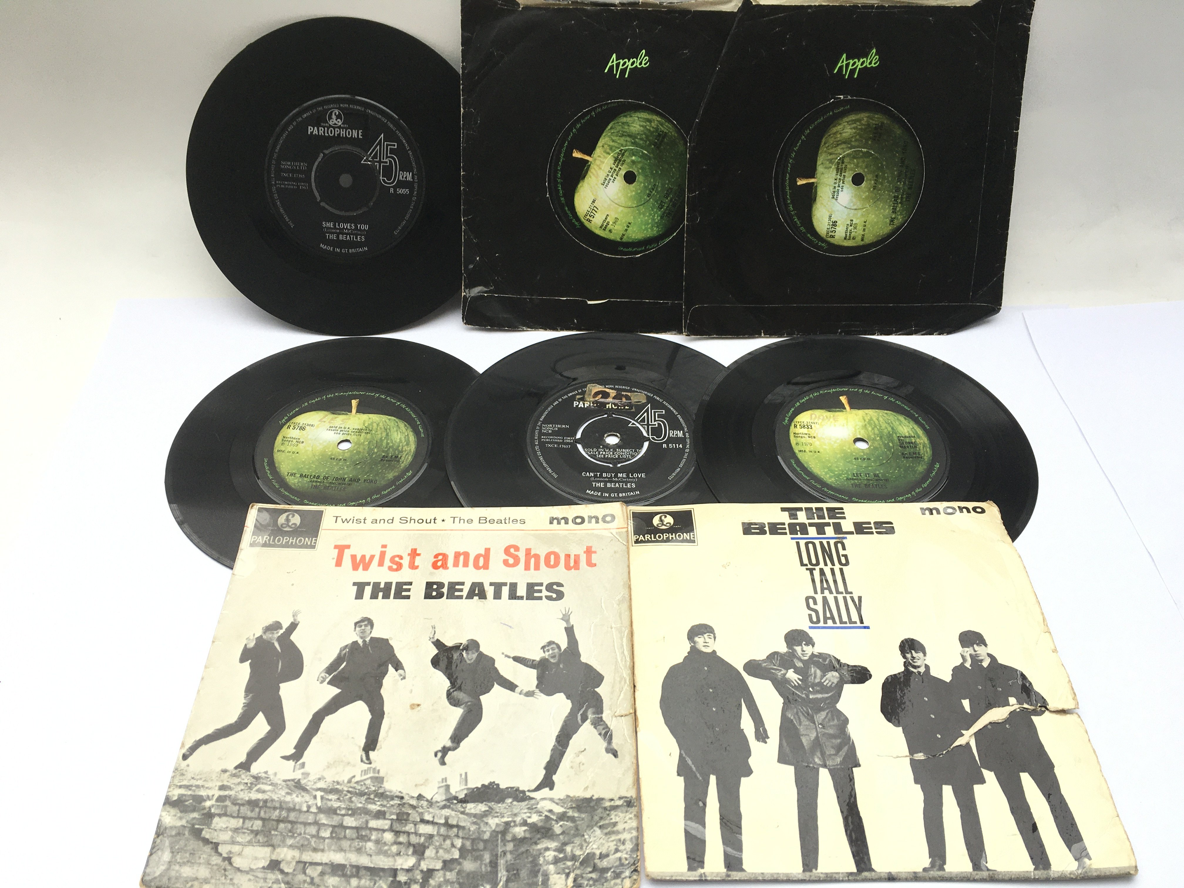 Two Beatles EPs and six 7inch singles.