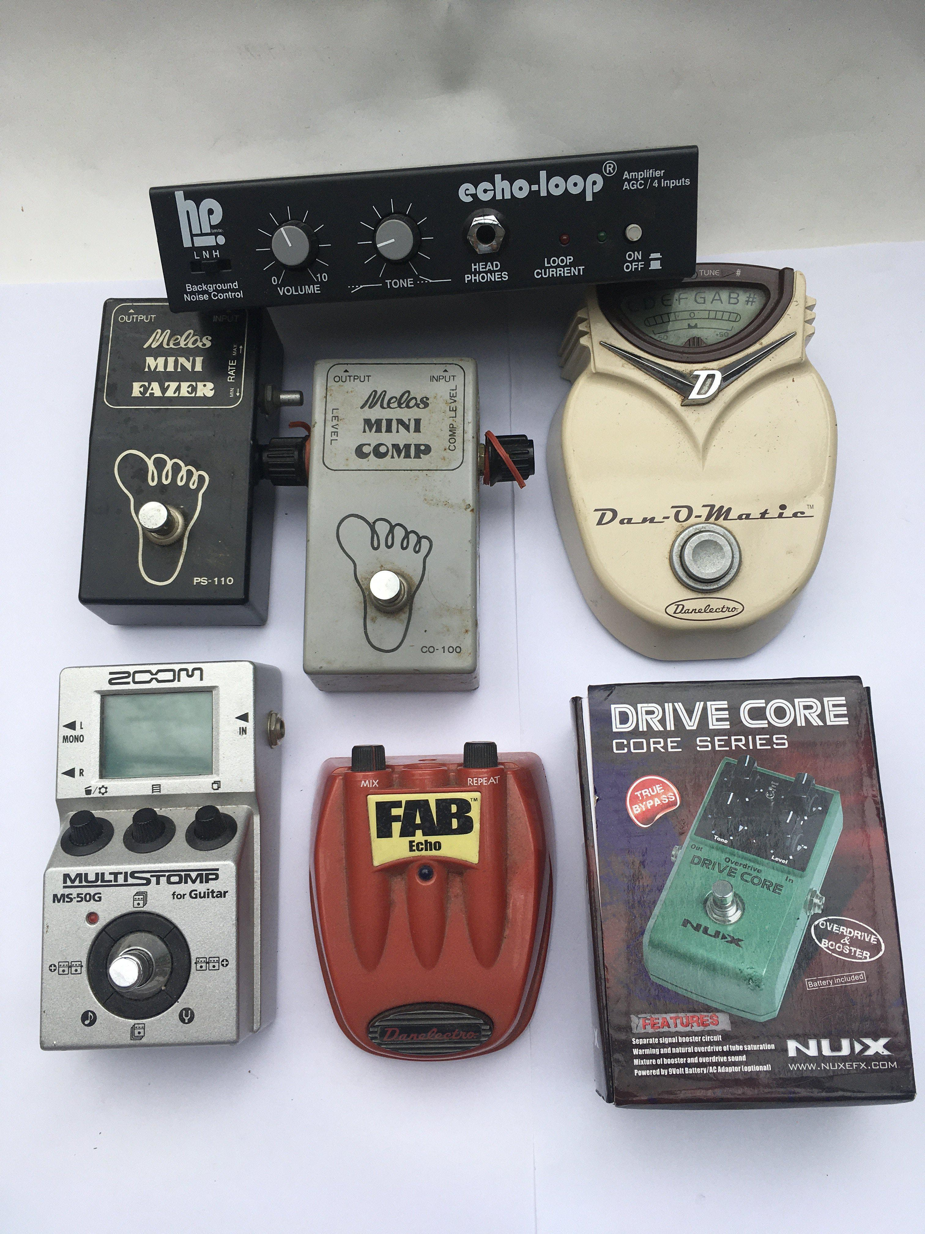 A collection of guitar effects pedals comprising a