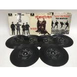 Three Beatles EPs and a collection of Beatles 7inc