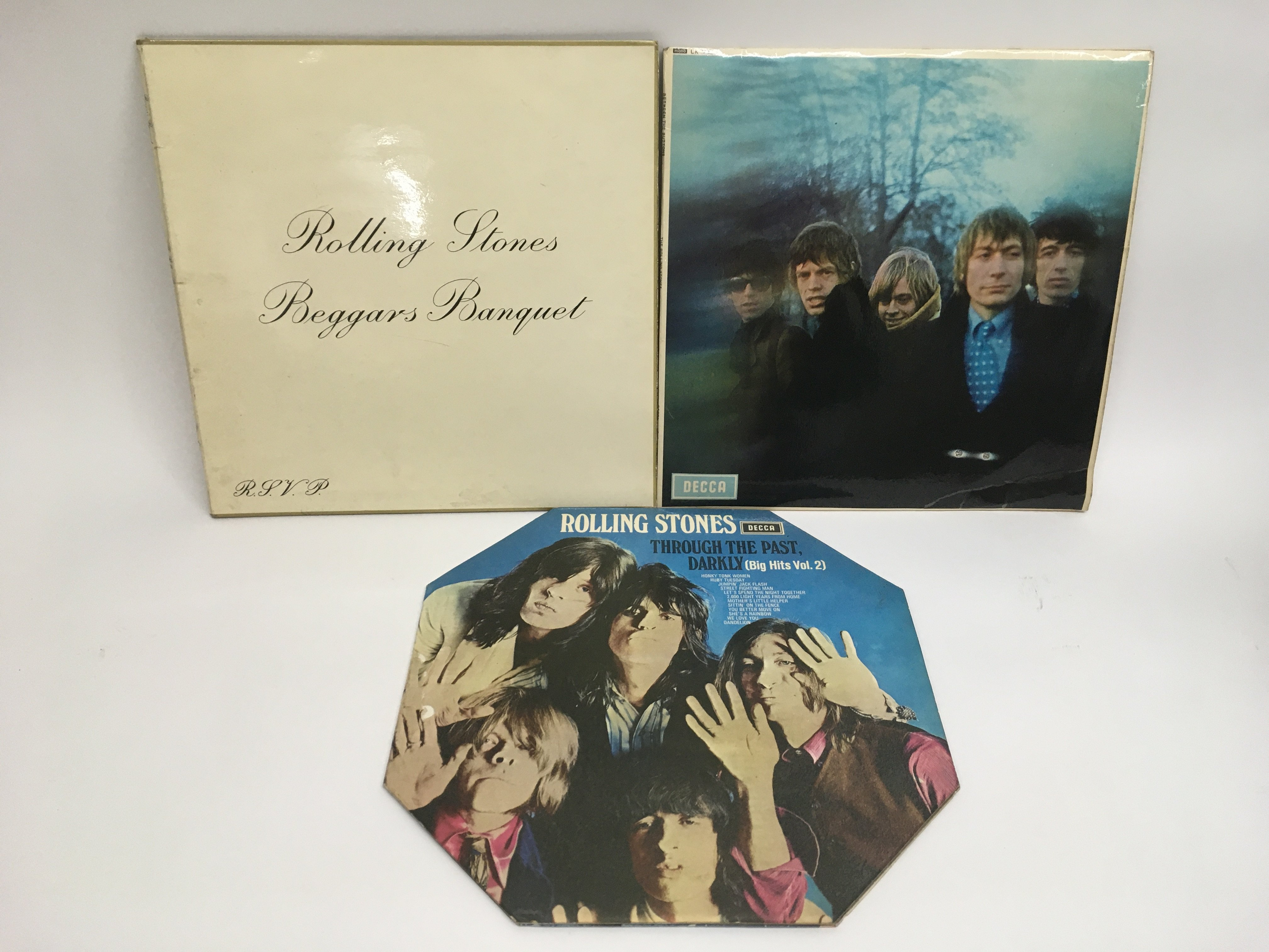 Three early UK pressings of Rolling Stones LPs com