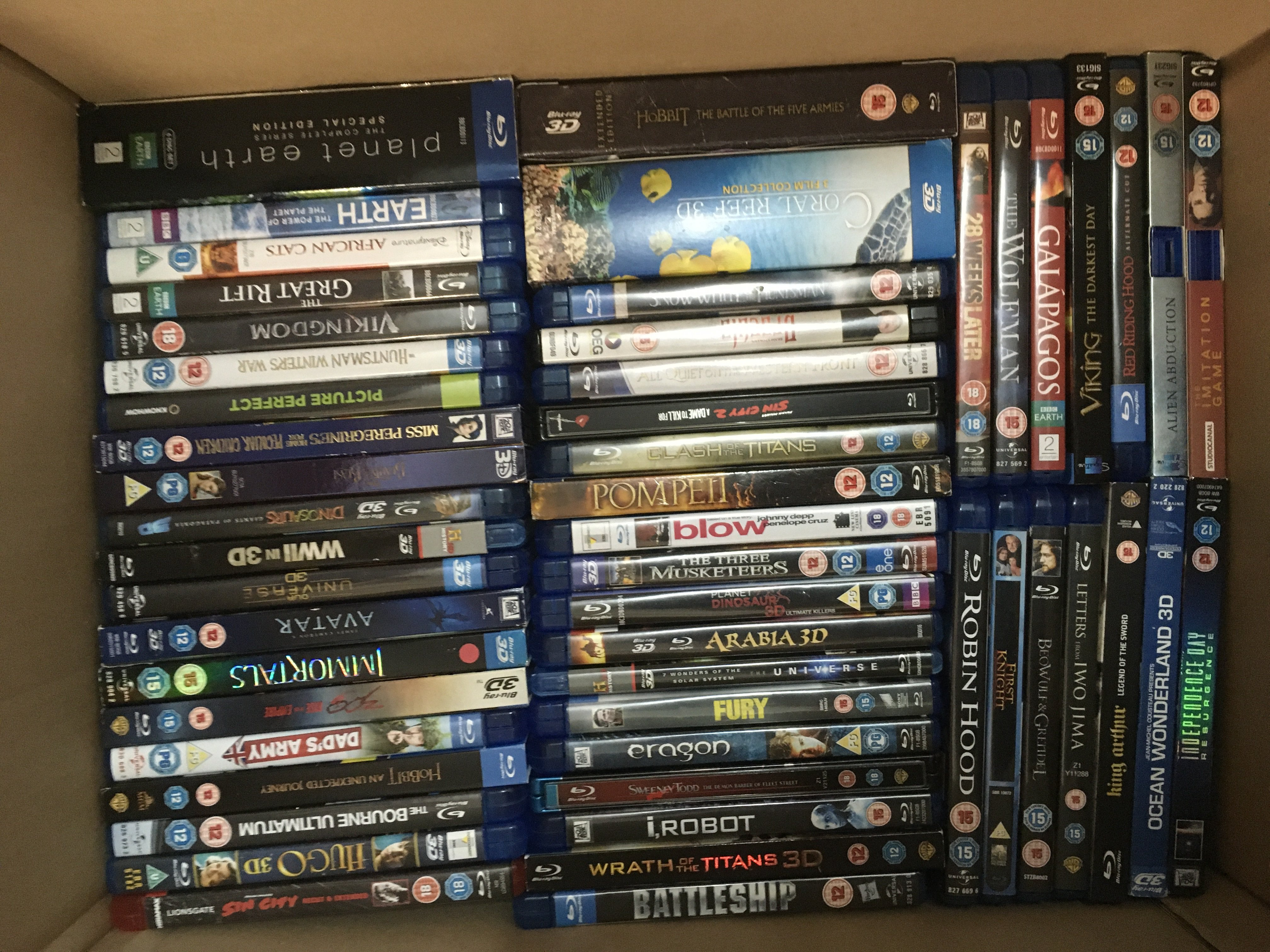 A box of blu rays, various titles.