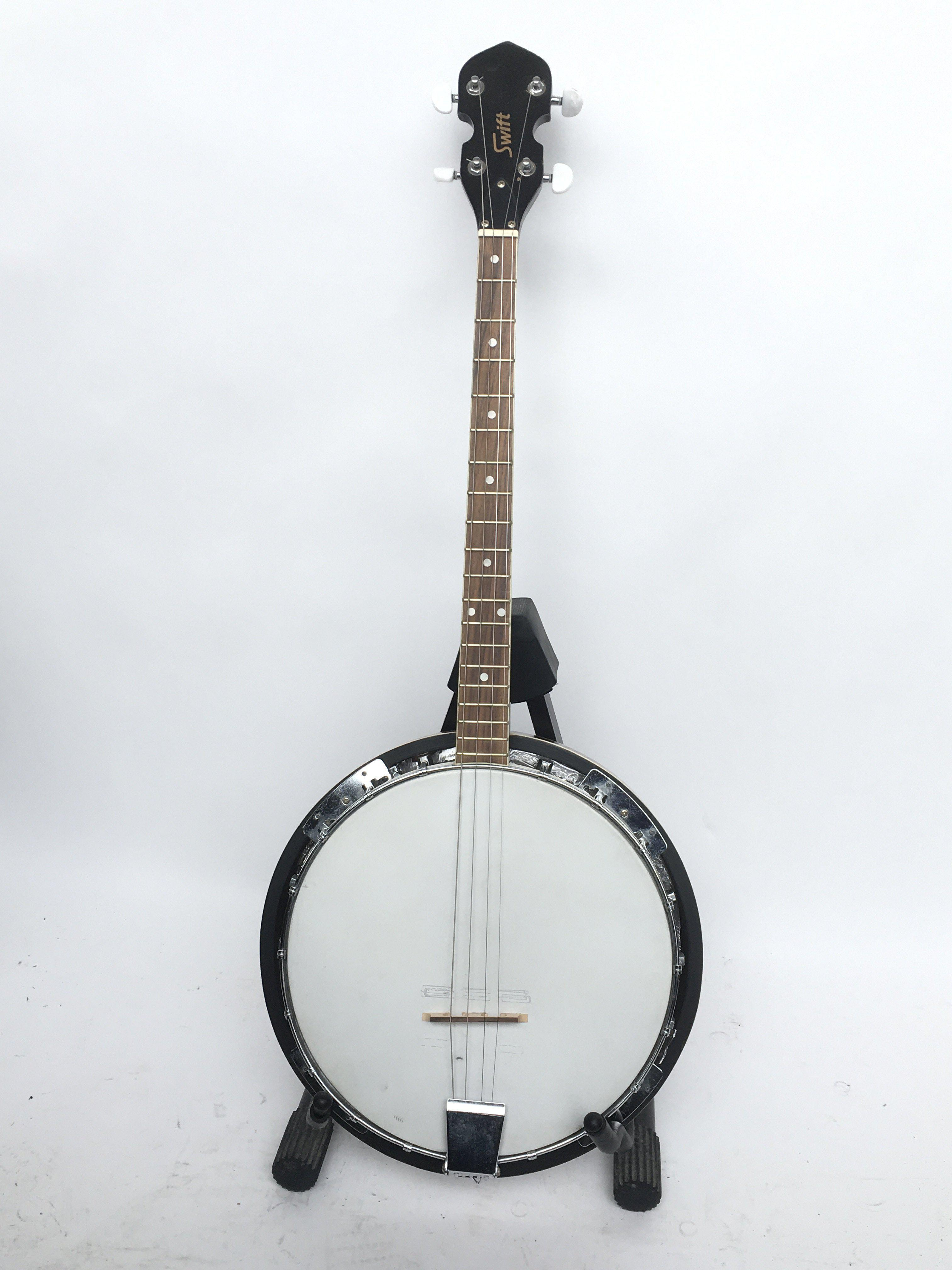 A Swift four string banjo with soft carry case.