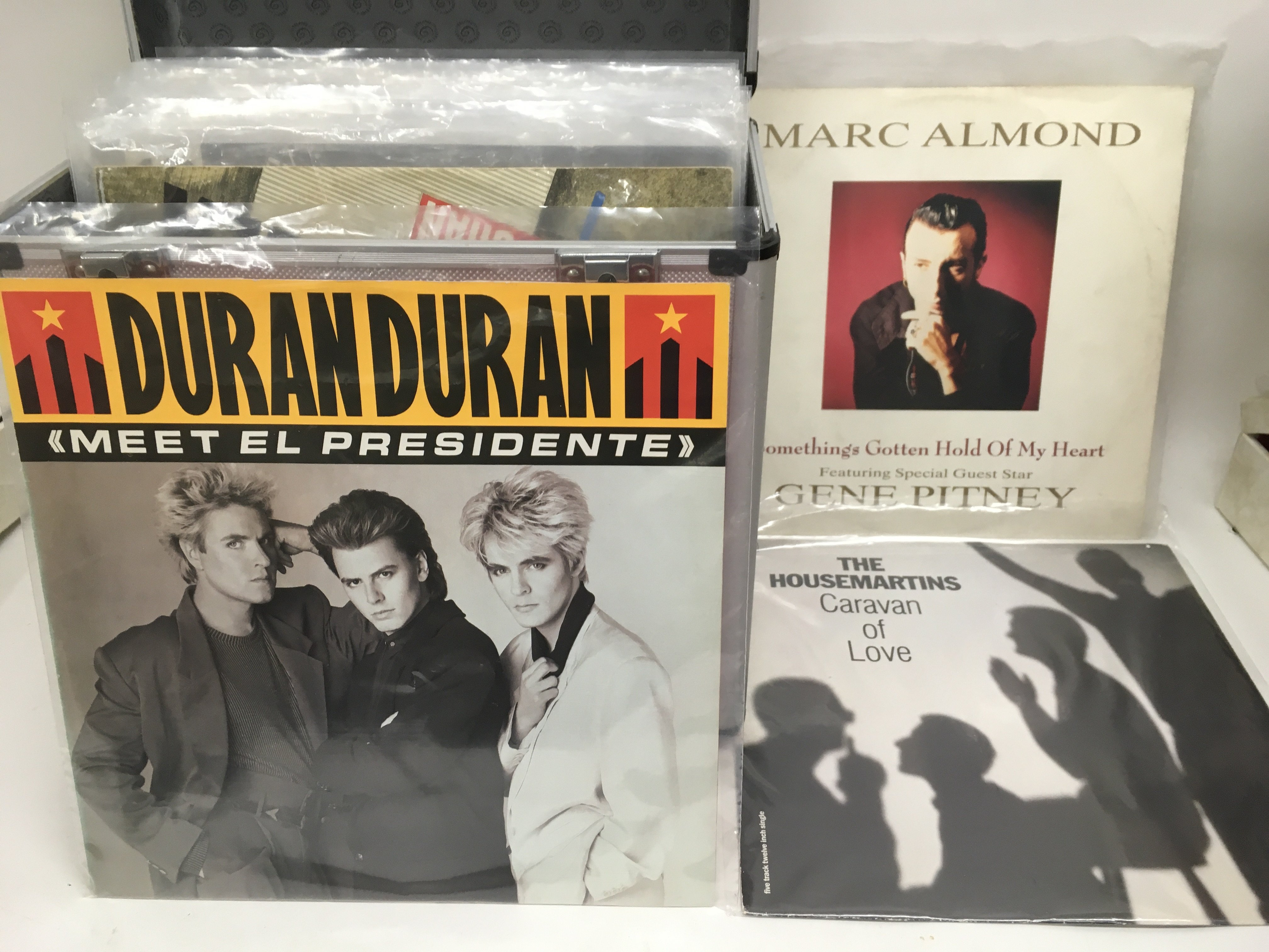 Three record cases of mainly 80s and 90s pop 12inc