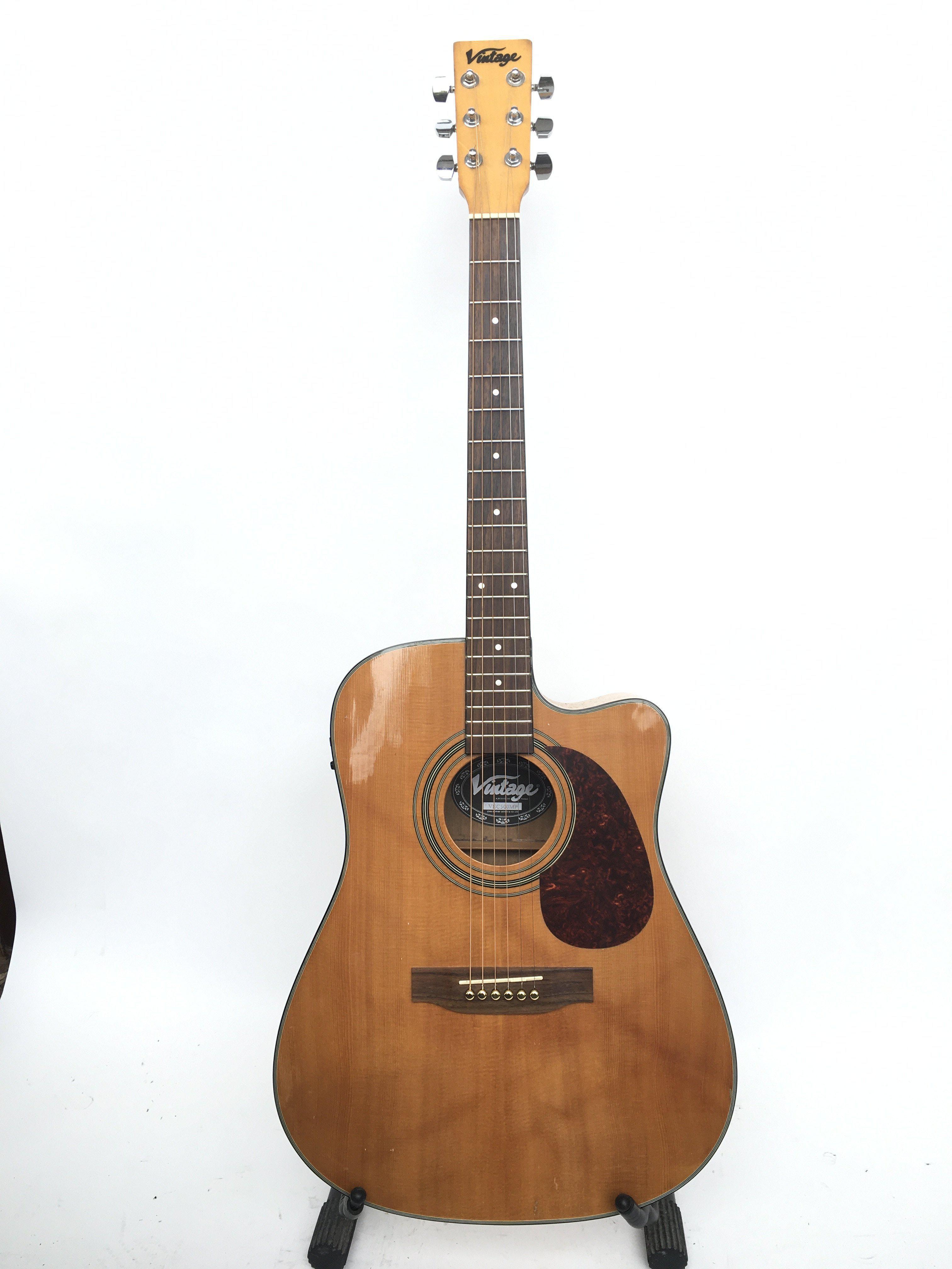 A Vintage VEC500MP electro acoustic guitar. Comes