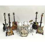 A collection of miniature iconic Beatles instrumen