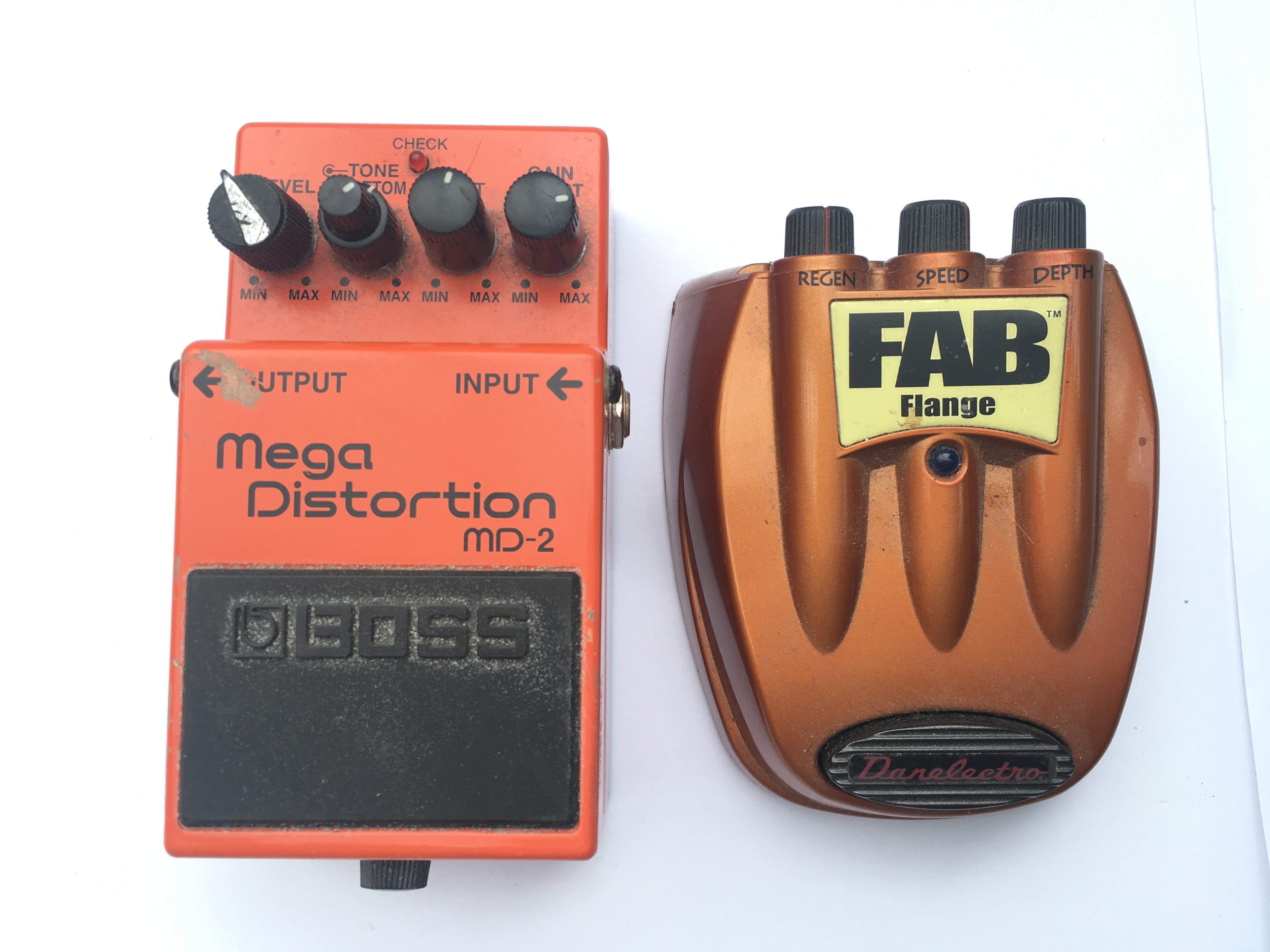 Two guitar effects pedals comprising a Boss MD2 an