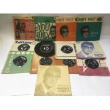 A collection of Buddy Holly 7inch singles and EPs.