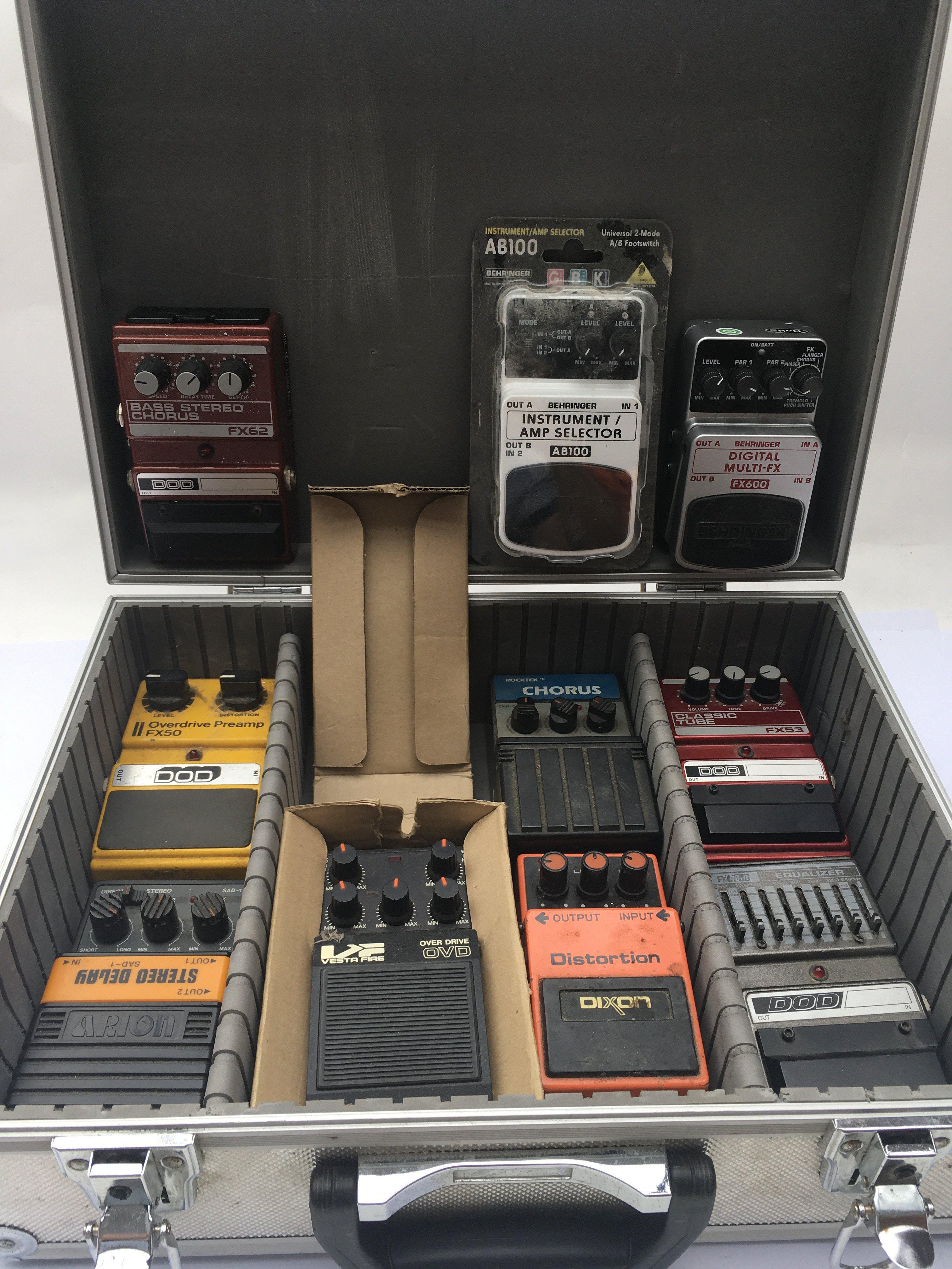 A case of guitar effects pedals including a Dod FX