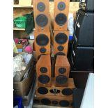 A set of eight Linn surround sound speakers compri