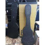 Three hard shell guitar cases together with three