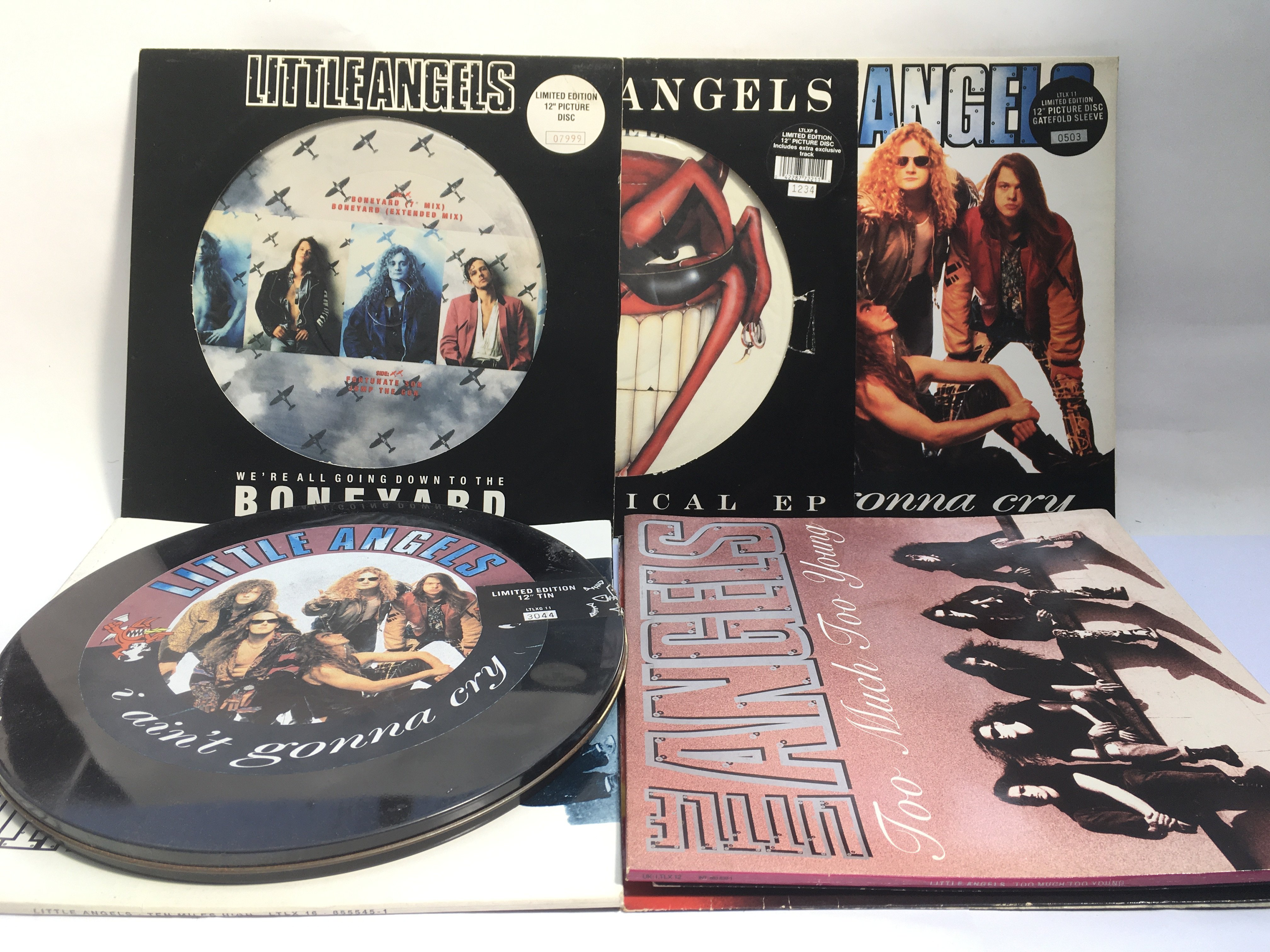 A collection of rock LPs and 12inch singles compri