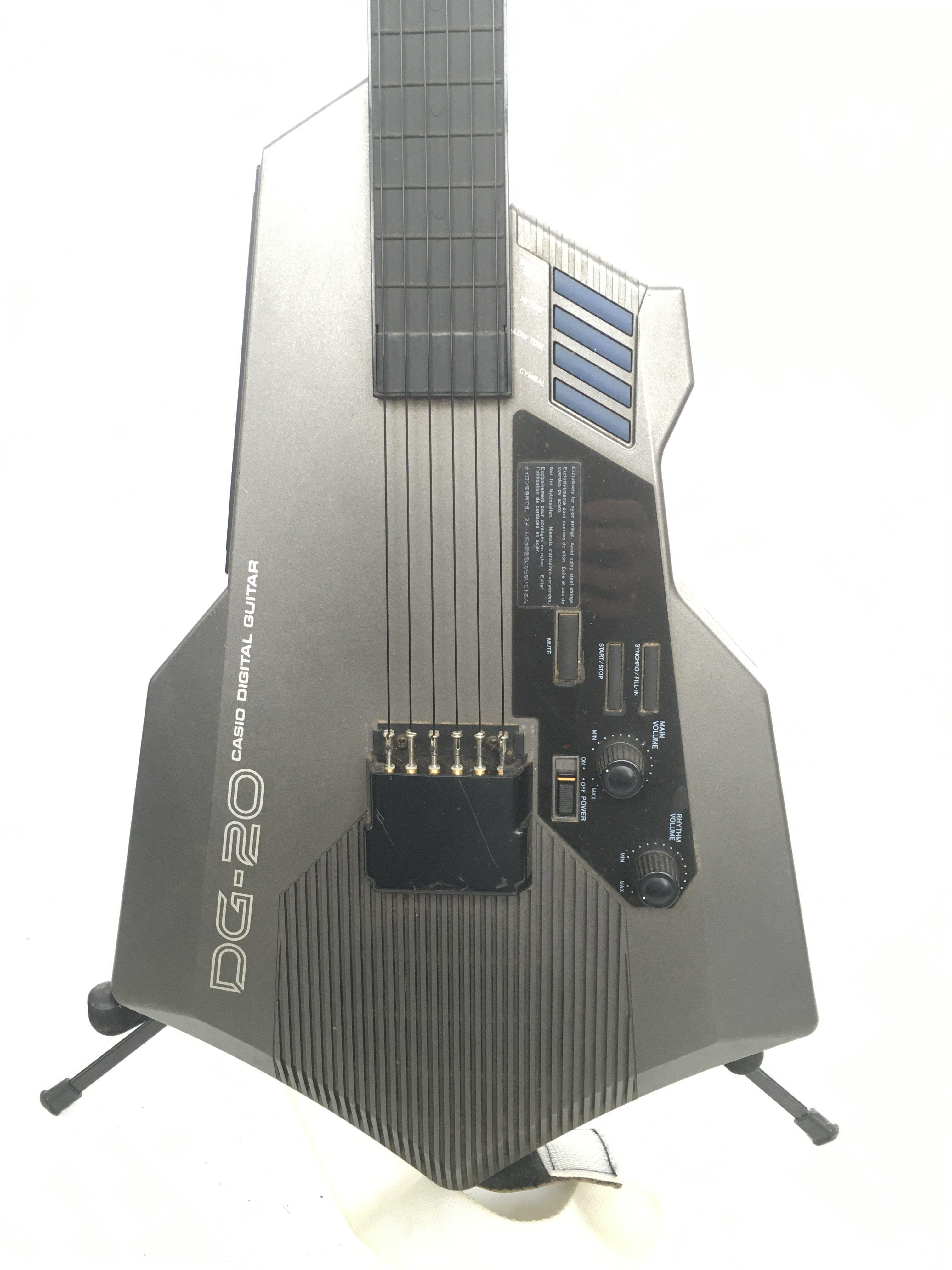 A Casio DG20 synth guitar. Comes supplied with a h - Image 2 of 3