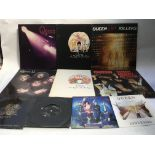 A collection of Queen LPs and 7inch singles compri