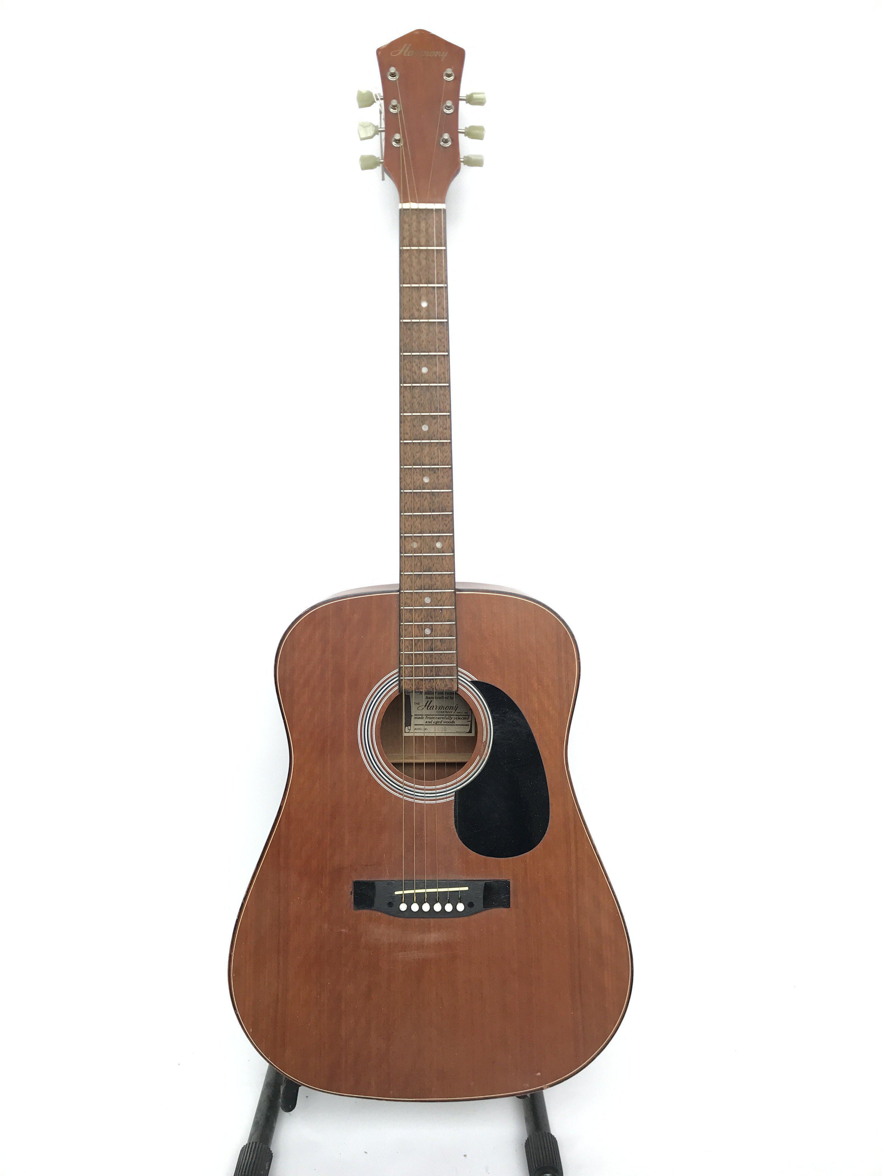 A vintage Korean made Harmony acoustic guitar (mod