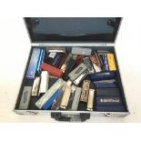 A case of over 30 harmonicas, various makes includ