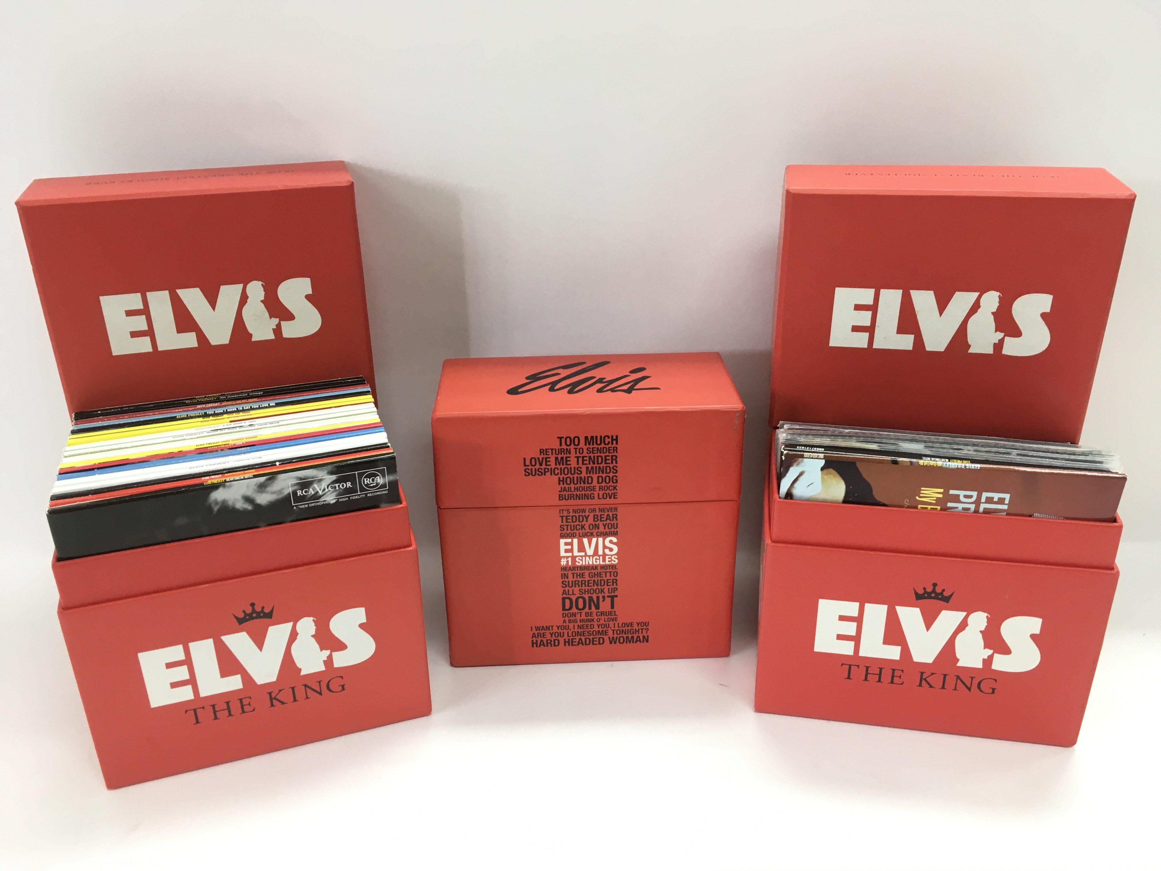 Three Elvis Presley CD box sets, one incomplete.