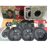 A collection of Elvis Presley EPs and 7inch single
