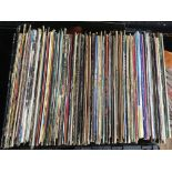 A black crate of LPs and 12inch singles by various