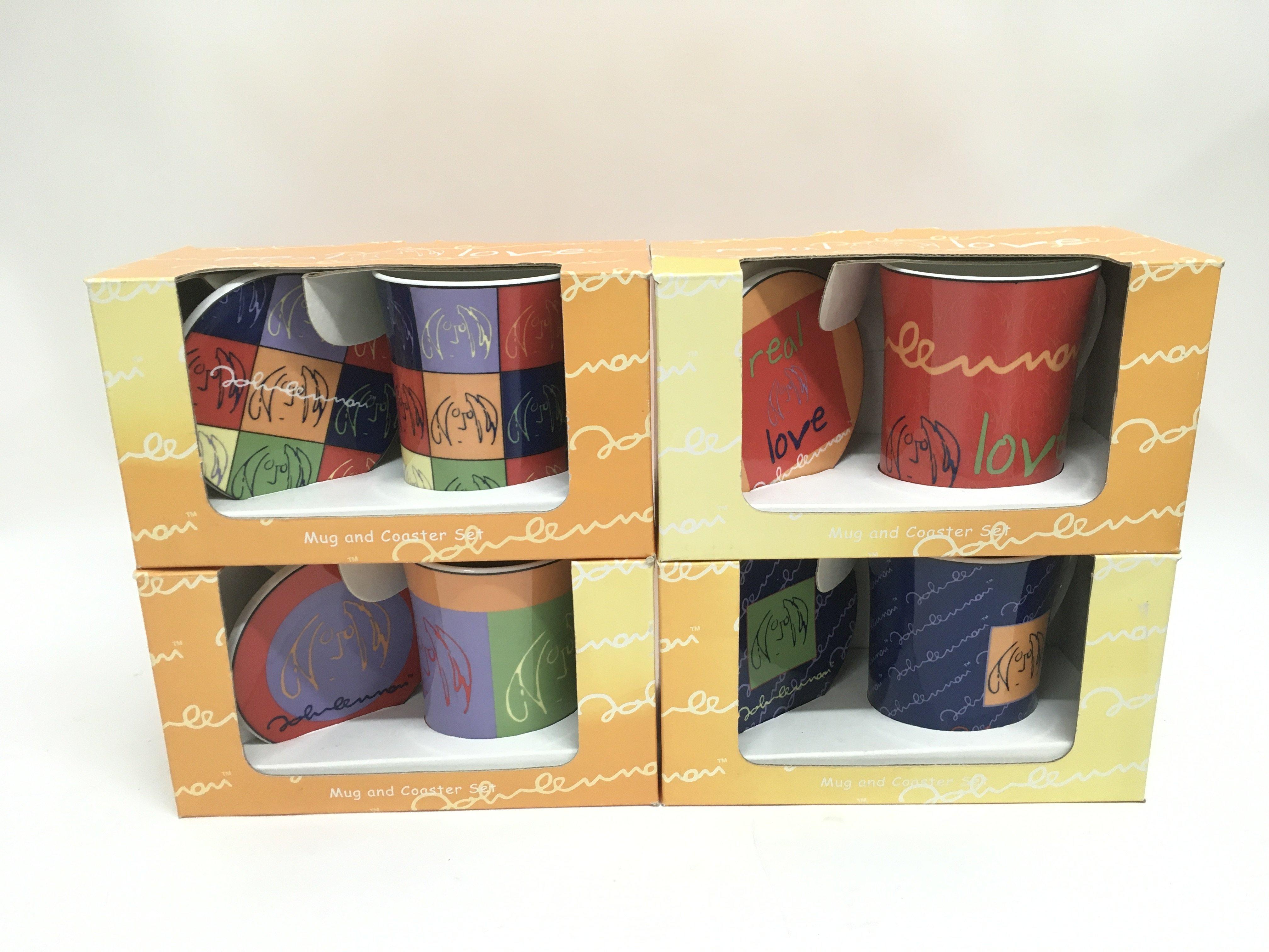 Four boxed Coalport John Lennon mugs and coasters