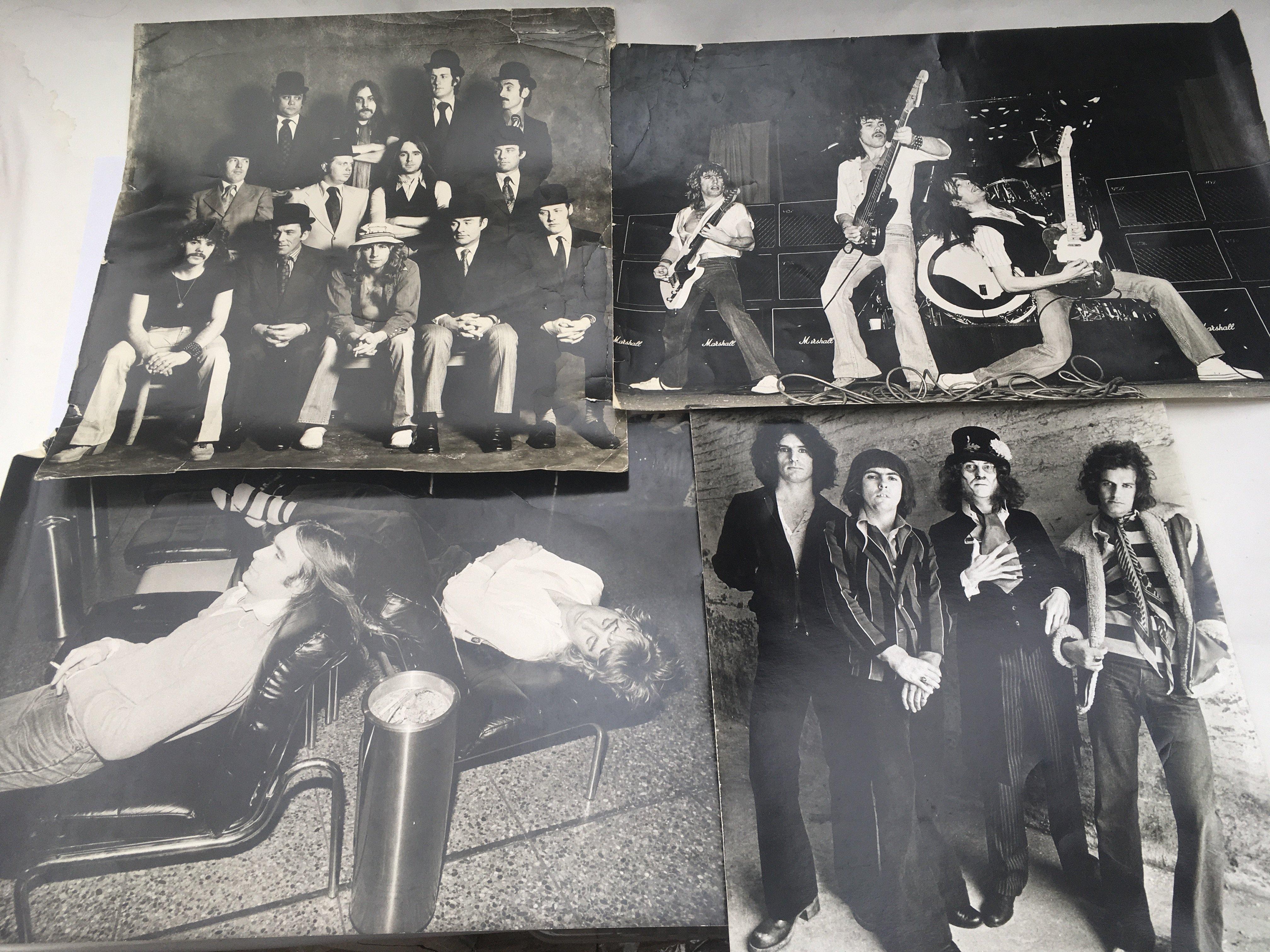 Four large original studio printed photographs com