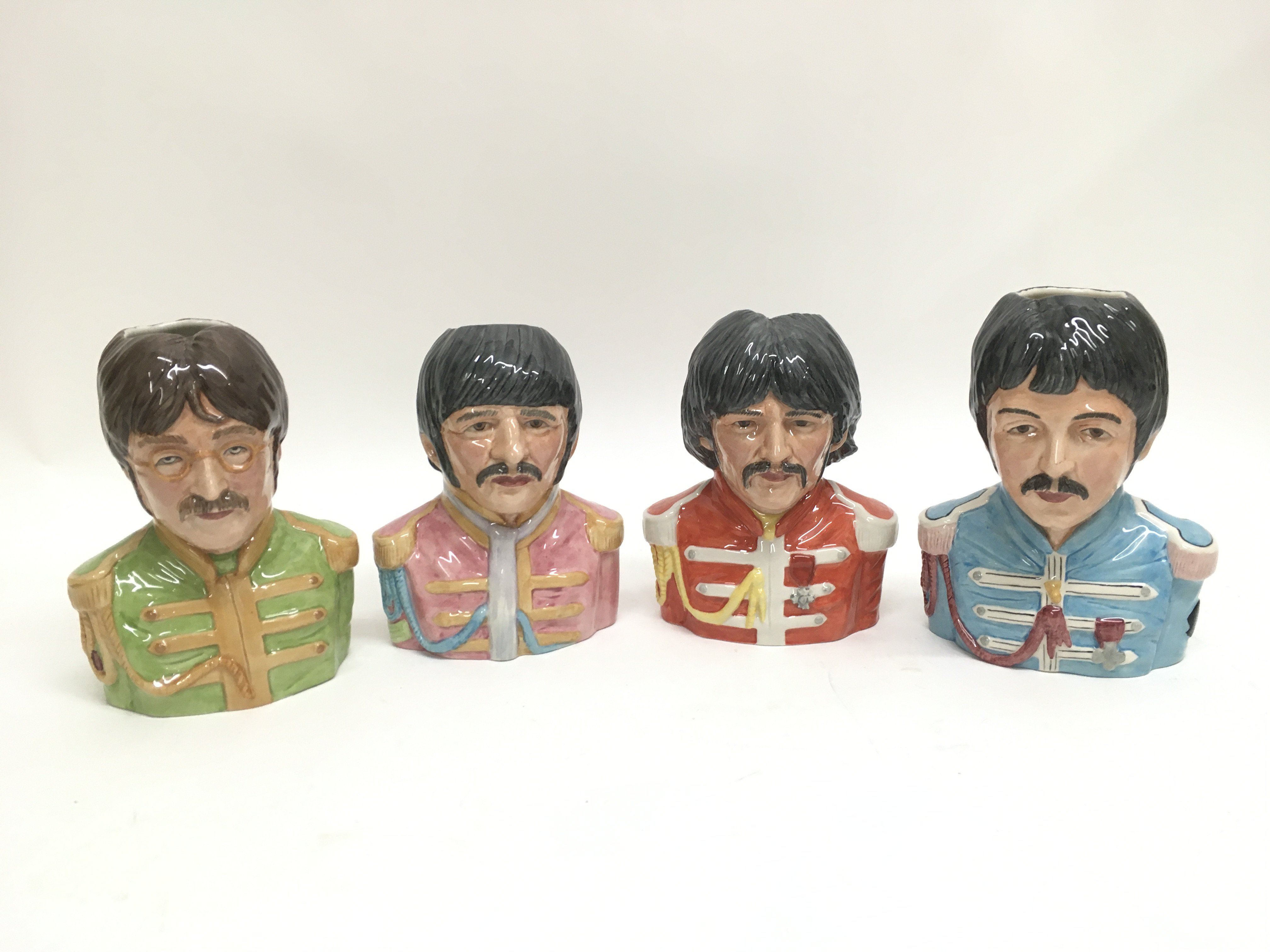 A set of four limited edition Ray Noble Beatles To