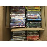 A large box of DVDs including films and TV series.
