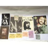 A collection of concert programs and tickets. Arti