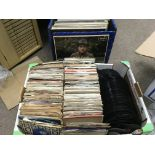 A record case of comedy LPs and a box of 7inch sin