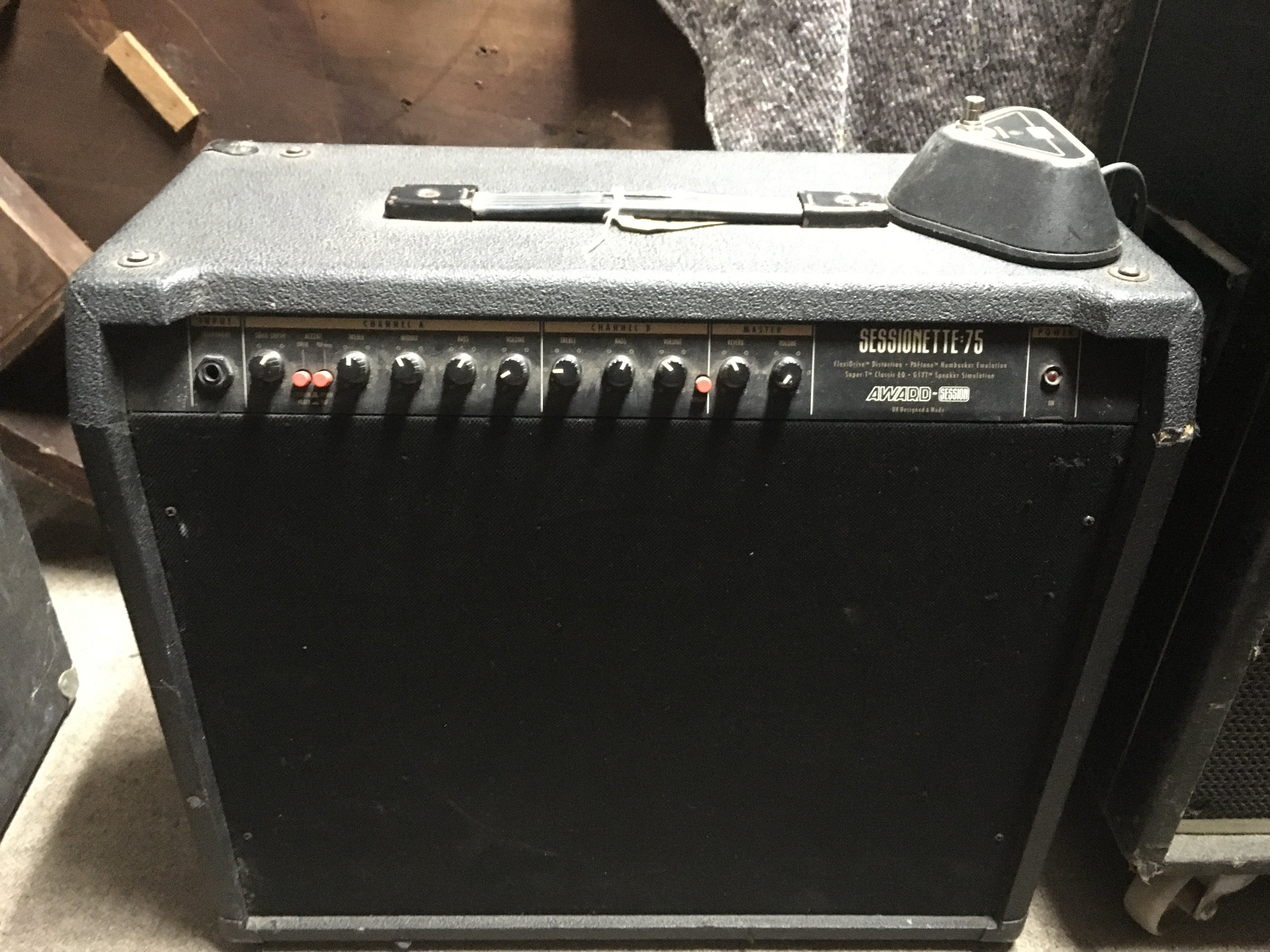 A Sessionette 75 guitar amplifier with footswitch.