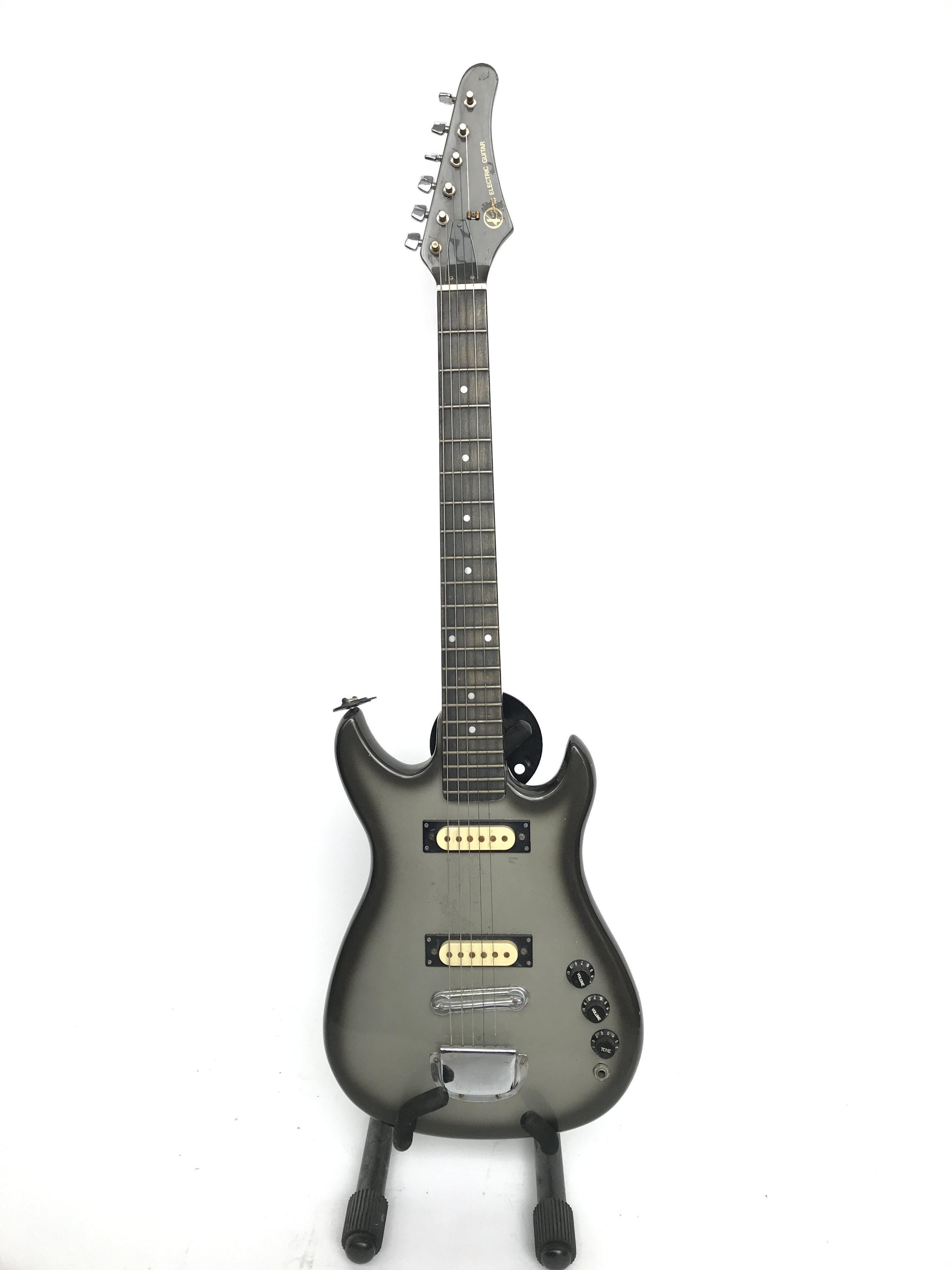 An unusual small scale Kay electric guitar, estima