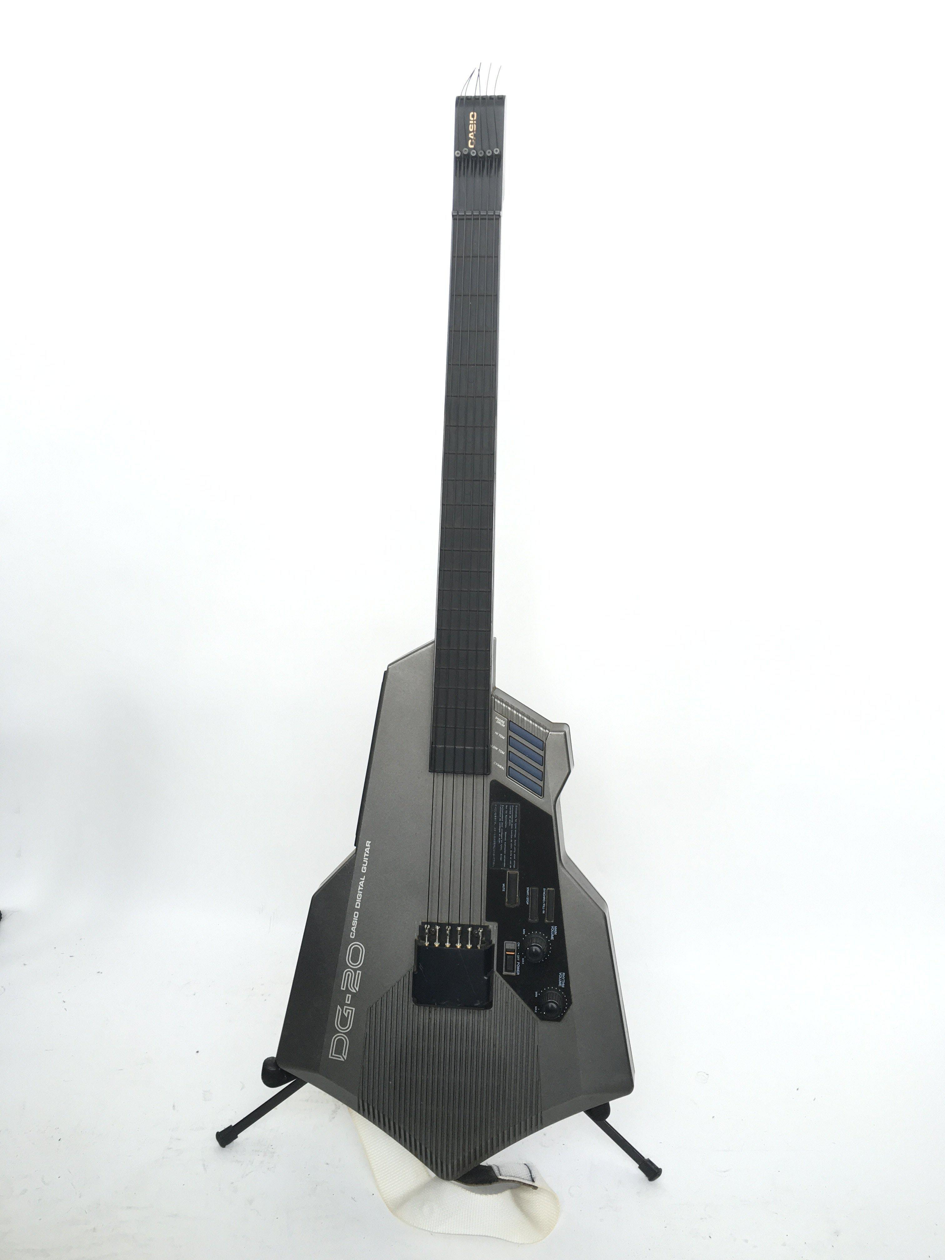 A Casio DG20 synth guitar. Comes supplied with a h