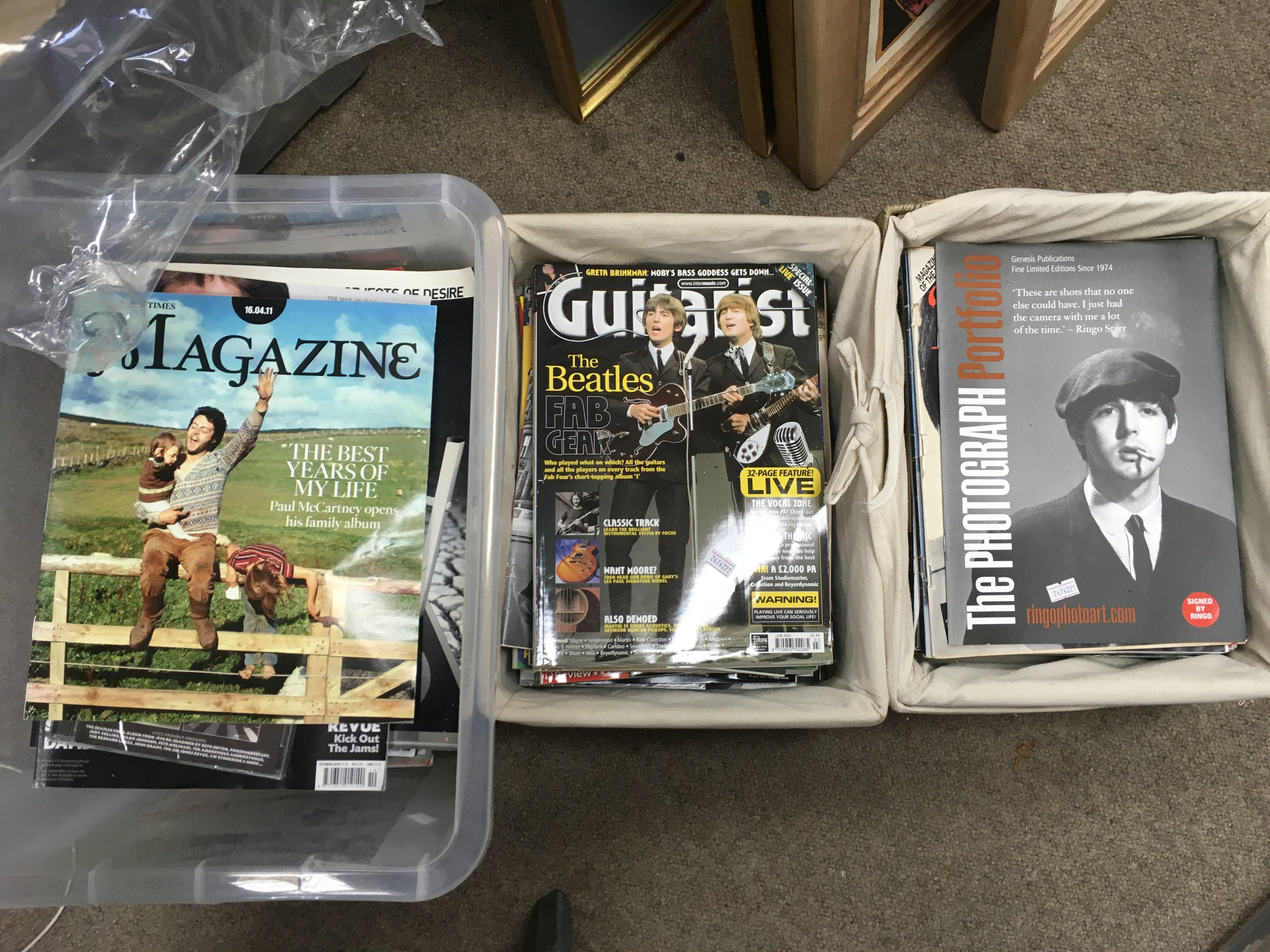Three boxes of Beatles related music magazines com