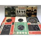 Three Beatles EPs and six 7inch singles.