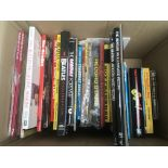 A box of Beatles and 60s pop music books.