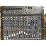 A Yamaha MX12/4 mixing console with instructions.