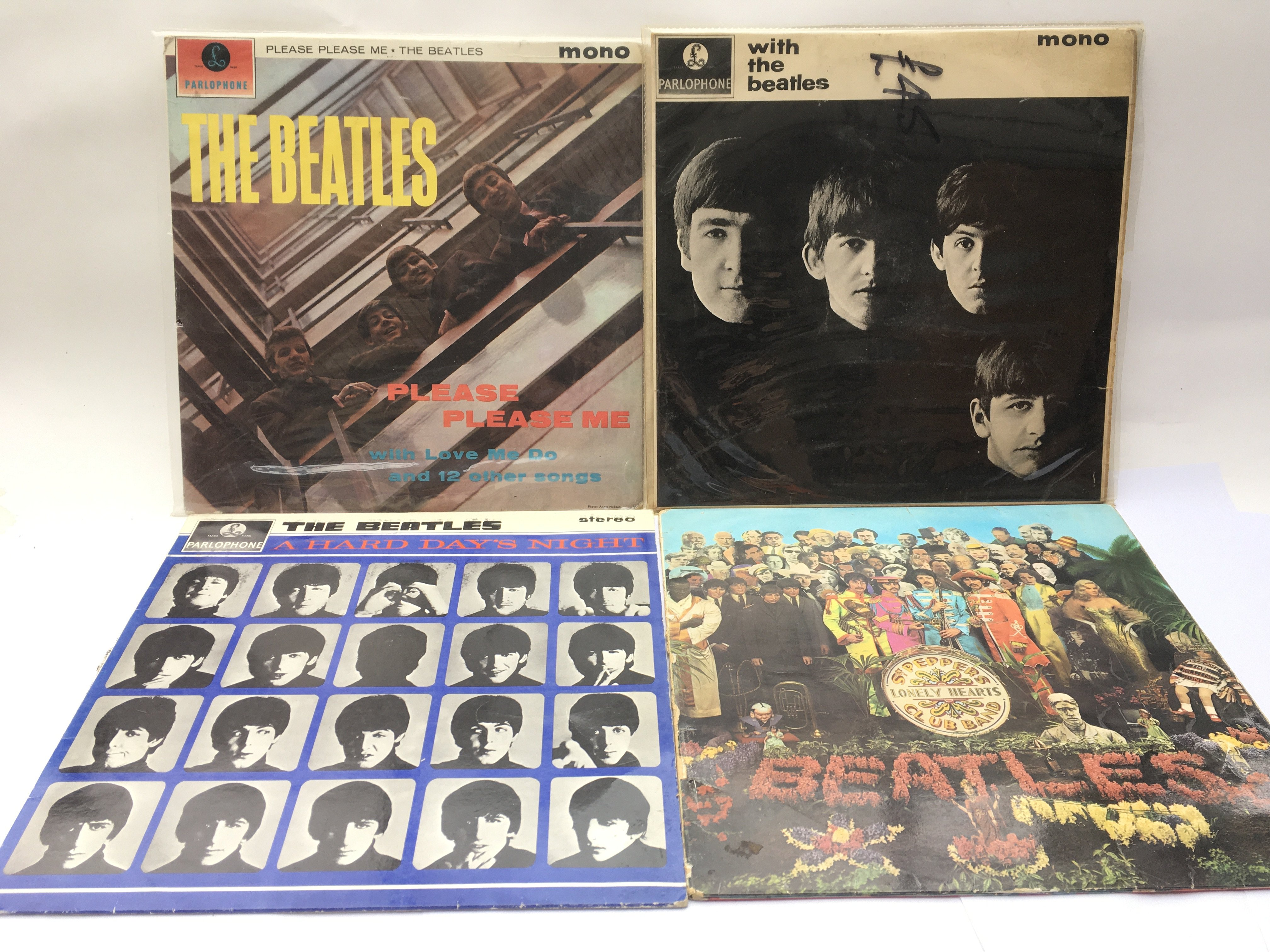 Four early UK issue Beatles LPs comprising 'Please